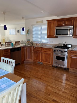 Harwich Port Cape Cod vacation rental - Open Floor Plan Kitchen with breakfast bar plus dinning table