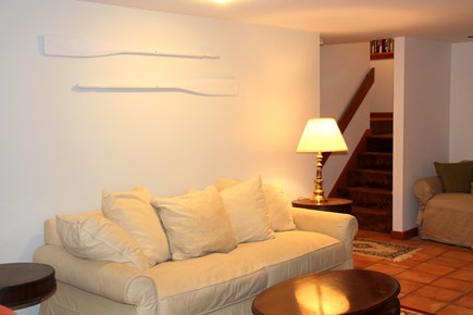 Brewster Cape Cod vacation rental - Lower level living room with sofa bed and slider to back yard