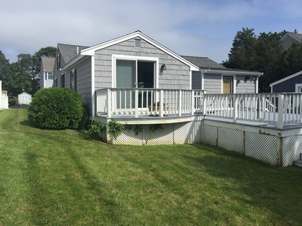 Mashpee, Popponesset Cape Cod vacation rental - Back yard and master slider deck