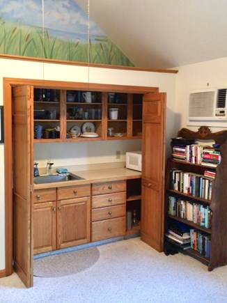Orleans Cape Cod vacation rental - The kitchen area has many counter appliances, but no stove.
