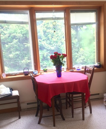 Orleans Cape Cod vacation rental - The dining table overlooks a mimosa tree in season.