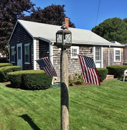 South Yarmouth Cape Cod vacation rental - A bright and playful yard to enjoy or rest in the sunshine!