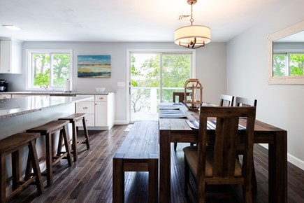 Barnstable Cape Cod vacation rental - Open kitchen and dining area with deck access