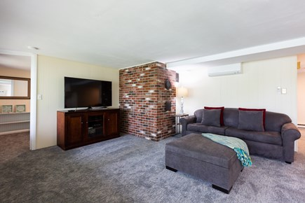 Barnstable Cape Cod vacation rental - Lower living area with access to backyard. New carpets and paint!