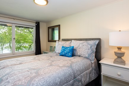 Barnstable Cape Cod vacation rental - Full bedroom on lower level with views of the pond