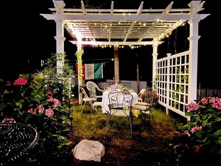 Brewster Cape Cod vacation rental - New backyard pergola....perfect for a summer's nite dining