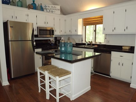 South Chatham Cape Cod vacation rental - Updated kitchen with granite counters and a breakfast bar.