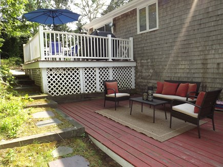 South Chatham Cape Cod vacation rental - Outside area showing the upper deck and patio.