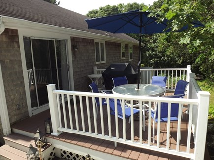 South Chatham Cape Cod vacation rental - Deck with gas grill and comfortable seating.