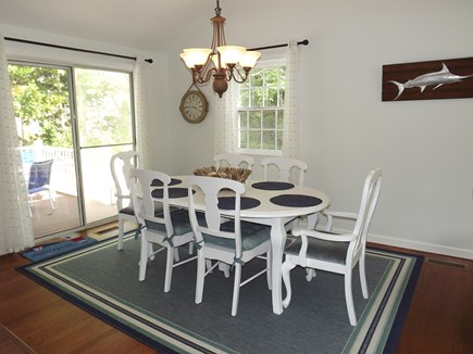South Chatham Cape Cod vacation rental - Dining area with a sliding door leading to the deck.