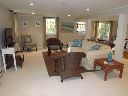 South Chatham Cape Cod vacation rental - Lower level living area with TV as well as two twin beds.