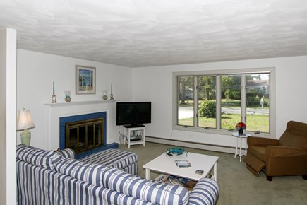 Chatham Cape Cod vacation rental - Living room with fireplace.