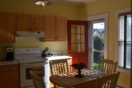 Provincetown Cape Cod vacation rental - Large Eat In Kitchen with access to rear patio and yard.