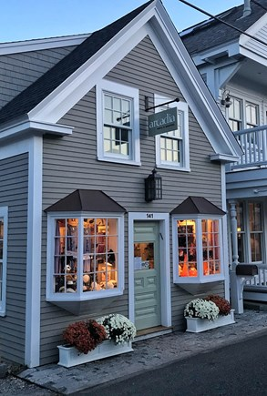 Provincetown Cape Cod vacation rental - The Map Building on Commercial St. The residence is in the rear.