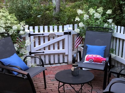 New Seabury, Maushop Village  New Seabury vacation rental - The charming rear patio is private and a great conversation spot.