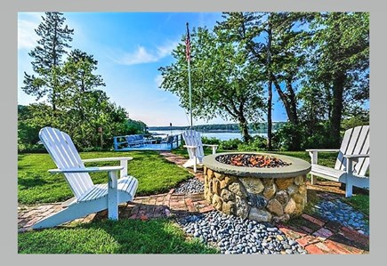 South Yarmouth Cape Cod vacation rental - Entertain guests at the backyard fire pit overlooking pond