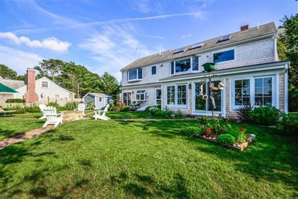 South Yarmouth Cape Cod vacation rental - Expansive backyard with sliders to house and deck to water