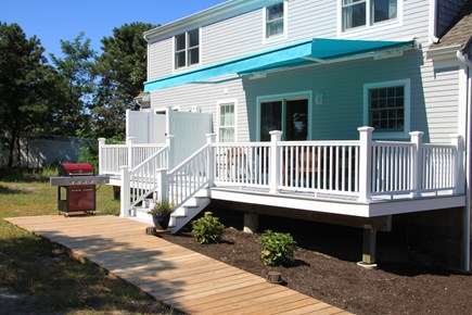 Eastham Cape Cod vacation rental - Big deck with outside shower, retractable awning, gas grill