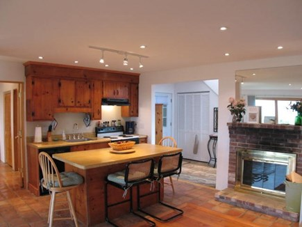 Brewster Cape Cod vacation rental - Cozy 1st level kitchen / dining area with fireplace.