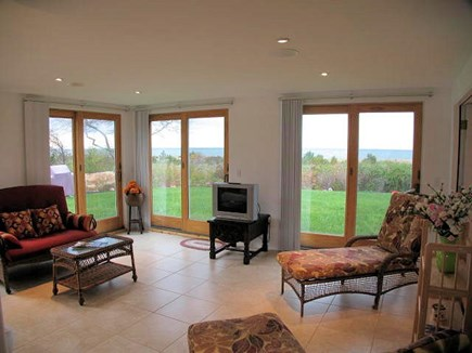 Brewster Cape Cod vacation rental - 1st level sunroom with great view