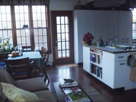 Woods Hole, Nobska Point Cape Cod vacation rental - Kitchen with table for 8 and sitting area with sofa
