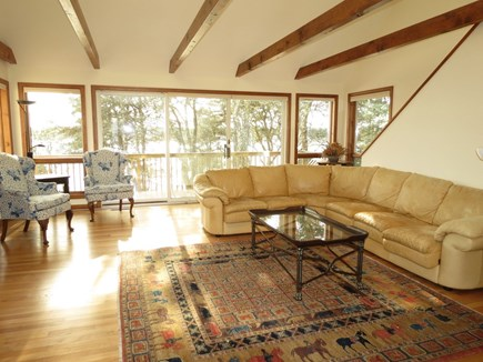 Harwich Cape Cod vacation rental - Comfy living room with atrium beamed ceiling overlooks the lake.