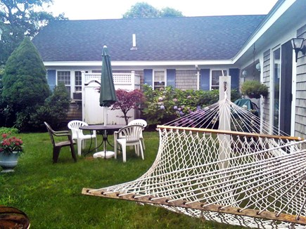 South Yarmouth Cape Cod vacation rental - Private backyard with outdoor shower, hammock & covered porch.