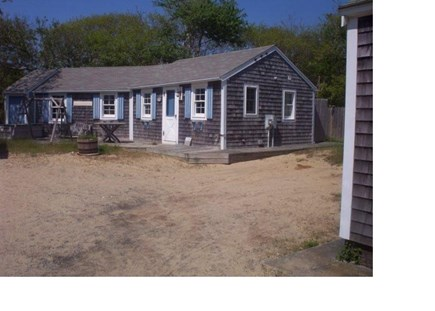 Dennis Cape Cod vacation rental - Front of cottage showing deck with water view.