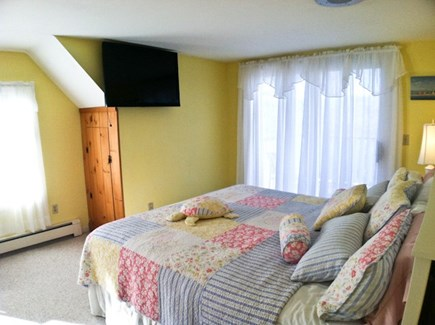 Harwich Cape Cod vacation rental - Master bedroom with sliders to deck with pond view