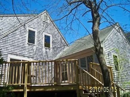 Harwich Cape Cod vacation rental - Deck side view. Gas BBQ, table and chairs are provided.
