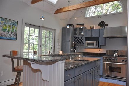 Provincetown Cape Cod vacation rental - Kitchen with center island eating area.