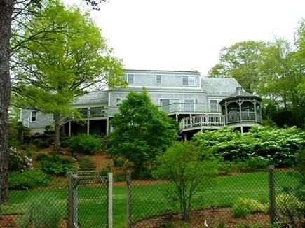 Orleans Cape Cod vacation rental - House & decks from sloping yard