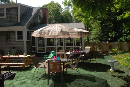 South Dennis Cape Cod vacation rental - Fun backyard with 2 grills, outdoor shower, volleyball net, more