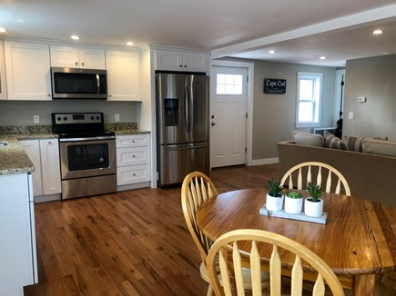 Eastham Cape Cod vacation rental - Open floor with kitchen and dining area