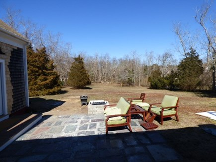 Brewster Cape Cod vacation rental - Large back yard with outside furniture and fire pit