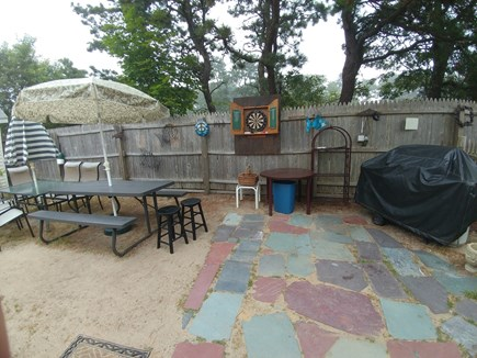 South Dennis Cape Cod vacation rental - Upper Level Entertainment area, Seating, Darts and Gas Grill