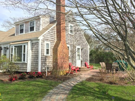 west harwich Cape Cod vacation rental - Looking on to side yard patio with new propane bbq.