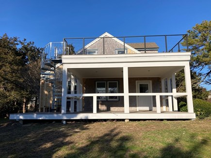 Pochet community, East Orleans Cape Cod vacation rental - New reconstructed porch and deck with enclosed outdoor shower.