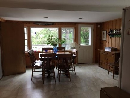 Pocasset Pocasset vacation rental - Kitchen overlooking deck/pond w/ large table with seating for 8.