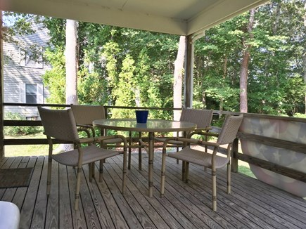 North Falmouth Cape Cod vacation rental - Covered Deck-Off of Eating Area and Leads to Backyard