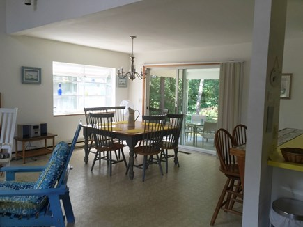 North Falmouth Cape Cod vacation rental - Eating Area with sliding doors to Covered Deck and Backyard