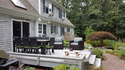 Dennis Village, North of 6A Cape Cod vacation rental - Large outdoor dining table and sitting area + easy access grill