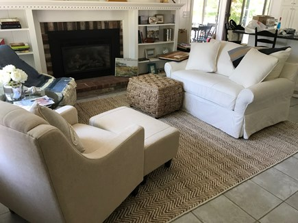 West Dennis Cape Cod vacation rental - Gas fireplace and club chairs. Views into kitchen