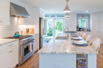 Chatham Cape Cod vacation rental - Kitchen slider out to a huge blue stone patio