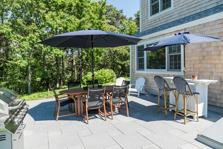 Chatham Cape Cod vacation rental - Outdoor bluestone patio with table for 6, outdoor bar & grill