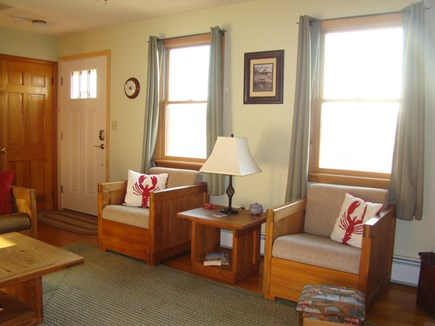 North Truro Cape Cod vacation rental - cozy living room, with fireplace and a flat screen television.