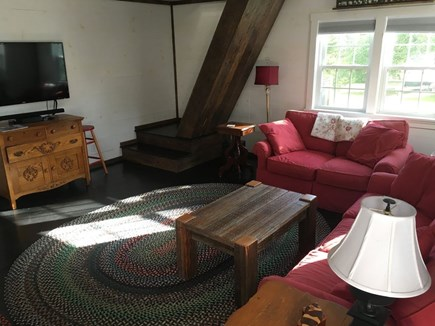 Harwich Port Cape Cod vacation rental - Barn - couch, love seat, TV, stairs to loft