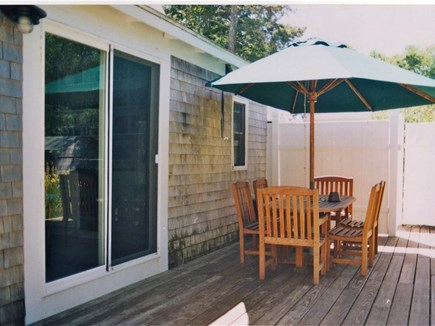 Wellfleet Cape Cod vacation rental - Beautiful deck with teak furniture overlooking back yard.