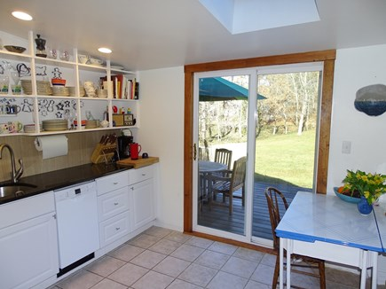 Wellfleet Cape Cod vacation rental - Sunny kitchen area with slider to deck, and second dining area