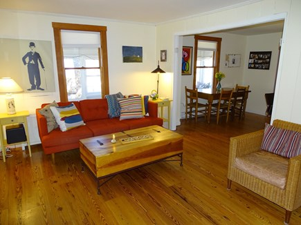 Wellfleet Cape Cod vacation rental - Living room with hardwood floors, TV, opens to dining